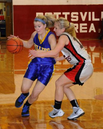 Ron Gower/TIMES NEWS Marian's Kaysi McLaughlin tries to get around Tri-Valley defender Rayne Newswaner.
