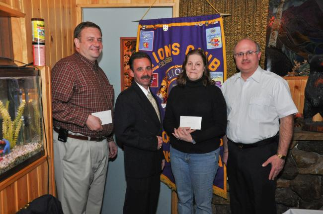AMY MILLER/TIMES NEWS Representatives of the three fire companies that serve Nesquehoning accept $1,000 donations from Michael McLaughlin, Nesquehoning Lions Club president, second from left. With him are, from left, John McArdle, Nesquehoning Hose…