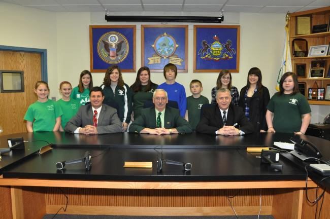 AMY MILLER/TIMES NEWS Members of Carbon County's 4-H program thanked county commissioners, from left, Thomas J. Gerhard, Wayne Nothstein and William O'Gurek, for their support of the program, now celebrating its centennial year. Carbon County 4-Hers…