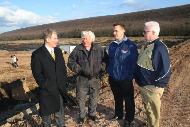 ANDREW LEIBENGUTH/TIMES NEWS Pictured on the dam are, from left, Sen. Dave Argall, Tamaqua councilman John Trudich, councilman Micah Gursky and Rep. Jerry Knowles.