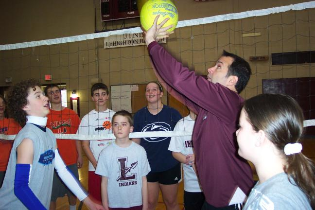 SPECIAL TO THE TIMES NEWS Faculty Member Ron Rabenold (with the ball) instructs students in serving the volley ball. From left are, Tanner Zwetolitz, Tyler Cann, Matthew Reppert, Gavin Cressley, and Cammi Nalesnik.