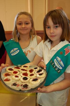 Gail Maholick/TIMES NEWS Ally Kemmerer and Jessica Mabus, members of Junior Troop 31102, offer cherry flavored Cukovi sweets to those attending Girl Scout Sunday and World Thinking Day programs.