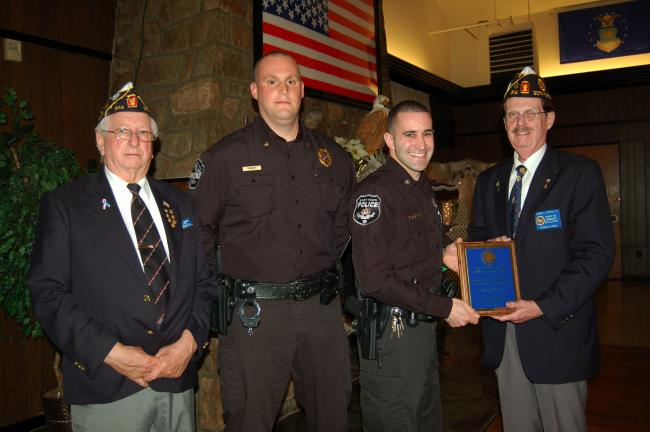 Gail Maholick/TIMES NEWS Lehighton American Legion Post 314 celebrated its 93rd birthday by recognizing a Law Enforcement Officer of the Year, Daniel K. Magarelli, an officer with East Penn Police Department. From left are Floyd Brown, commander;…