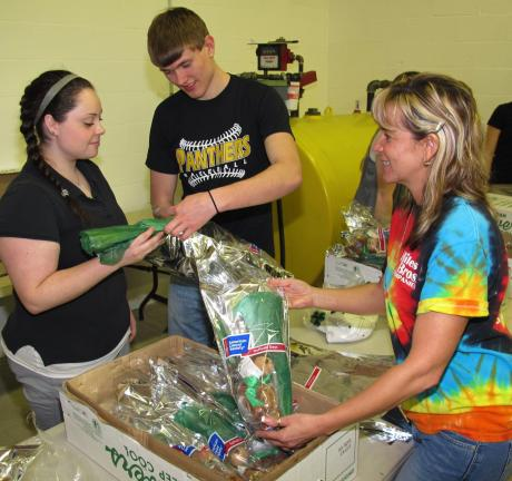 Preparing daffodils and bears are Panther Valley students Ashlee Miller, 18, and Tyler Smith, 17, and 15 year volunteer Lisa Hiles.