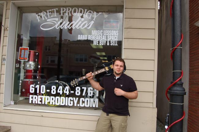 TERRY AHNER/TIMES NEWS Owner/instructor Tony Oriolo stands outside his Fret Prodigy Studios business at 415 Delaware Avenue in Palmerton.