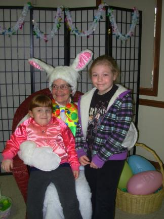 Julianna Cannarella, 4, left, and her cousin, 8-year-old Kaitlyn Lampke, took time to have their pictures taken with the Easter Bunny. They both live in Saylorsburg.
