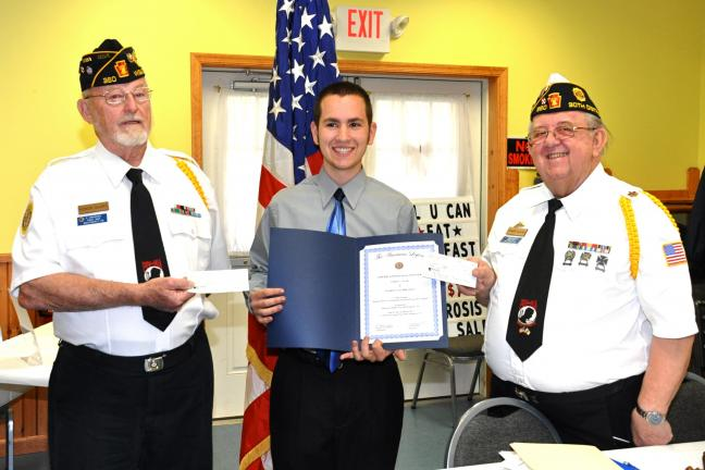 "VICTOR IZZO/SPECIAL TO THE TIMES NEWS Jared Nyer, winner of the American Legion Essay Contest on the subject ""Should America's Presidential electoral process be changed ?"", is presented with a check for $50 for placing first in the Post Competition…"