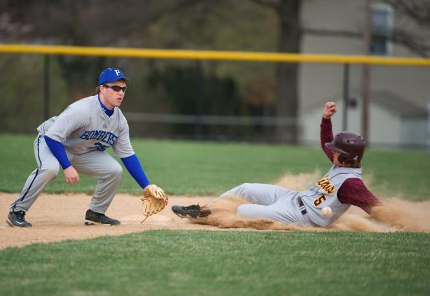Bob Ford/times news Lehighton's Parker David slides safely into second base during Thursday's game against Palmerton. Taking the late throw is the Bombers' Aaron Cook.