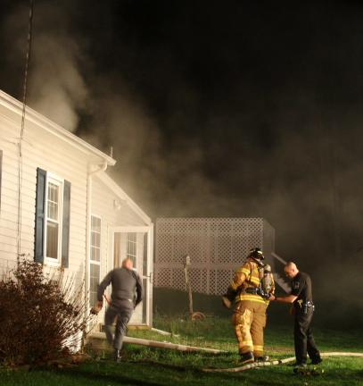 ANDREW LEIBENGUTH/TIMES NEWS Firefighters and police responded to a house fire on Ben Titus Road last night in Hometown.