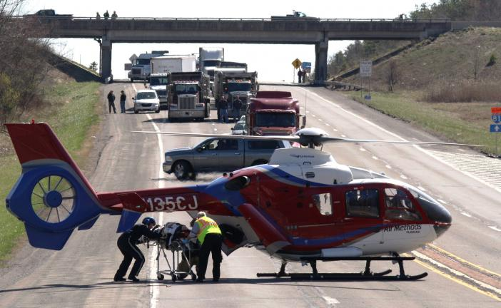 ANDREW LEIBENGUTH/TIMES NEWS Traffic on SR309 in Kline Township was backed up for about a mile while emergency personnel loaded an injured woman onto a helicopter following a motor vehicle accident involving a tractor trailer.