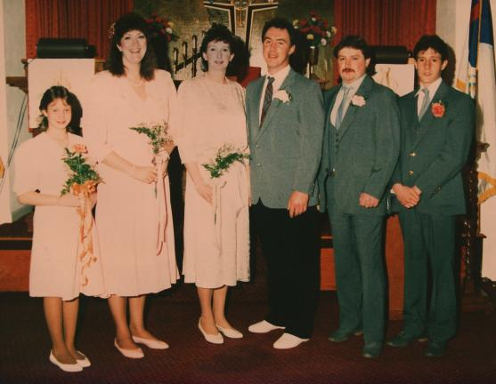 Mr. and Mrs. Jim Walck, center, on their wedding day.