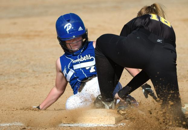 Bob Ford/TIMES NEWS Northwestern third baseman Nicole Metzger tags out a sliding Janel Tracy of Palmerton's during Monday's Centennial League softball game.