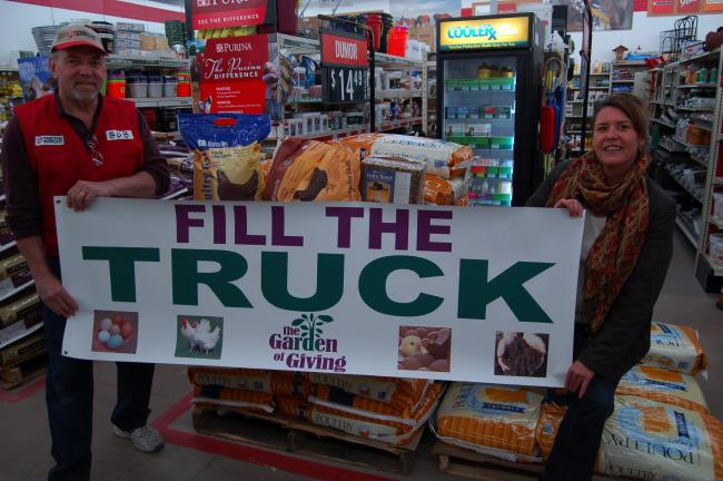 "LINDA KOEHLER/TIMES NEWS Brodheadsville Tractor Supply Company's store manager, Bob Hodgson and Tammy Graeber, director/founder of The Garden of Giving, are asking people to help ""Fill the Truck"" with supplies needed for The Garden's flock of…"