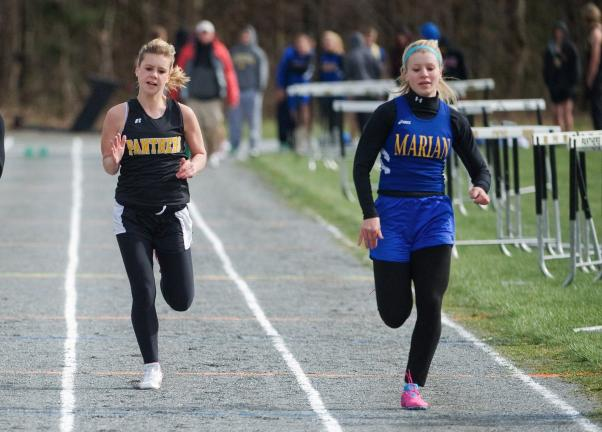 Marian sweeps Panther Vy.
