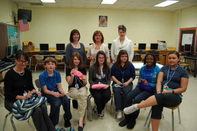 LINDA KOEHLER/TIMES NEWS The Crochet and Loom Knit Club at Pleasant Valley Middle School learns more than needlework and enjoy the comradery of their group. Some of the members are, sitting left to right: Mrs. Jennifer Dean, Connor Smith, Meaghan…