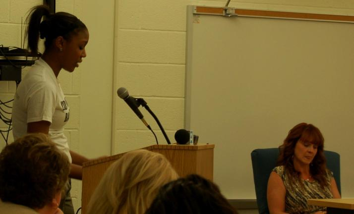 CHRIS PARKER/TIMES NEWS Lady Panthers forward Trayvonda Rice weeps as she pleads with the Panther Valley School Board to keep girls basketball coach Josh Wank. School Director Michelle Markovich, at right, voted to open the position.