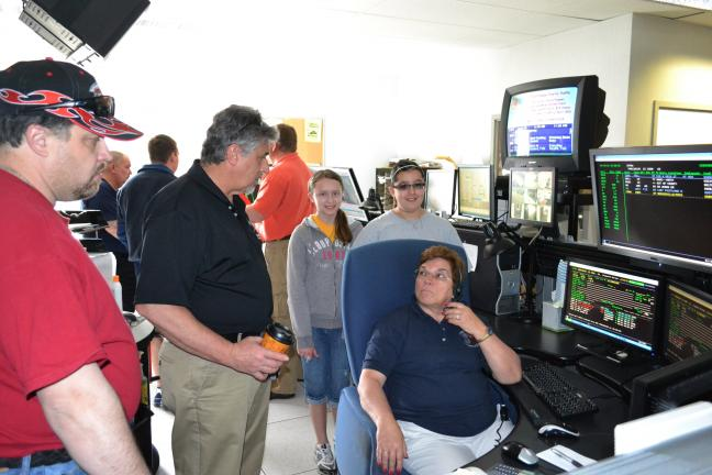 SHERI RYAN/SPECIAL TO THE TIMES NEWS Sandy Miller, seated, a 911 operator, demonstrates the 911 emergency communications system to Bowmanstown Fire Department members Clayton Billman, left, and Bruce Koch, center and to Kirstyn Kunkel and Lena Nalesnik.