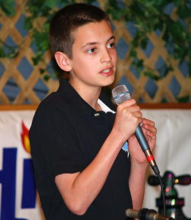 Mitchell Kurek, 12, sings in front of a live camera during the annual ACS telethon. Kurek was one of many Tamaqua's St. Jerome School's performing arts students who showed off their talent. Paul Mulhern's was the instructor.