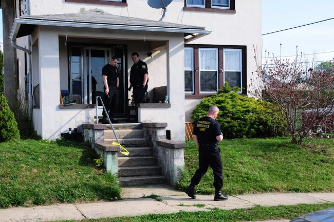 LARRY NEFF/SPECIAL TO THE TIMES NEWS A forensic team of the state police gather evidence at the scene of a stabbing early Monday morning at 626 Coal St., Lehighton.