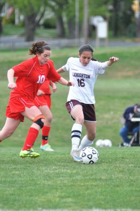 mike feifel/times news Lehighton's Amanda Acabou (16) tries to keep possession of the ball as Mya Snyder of PM East defends.