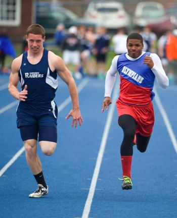 bob ford/times news Tamaqua's Tyler Hope (left) sprints to the finish line ahead of Jim Thorpe's P.J. Johnson in the 100 meter dash.