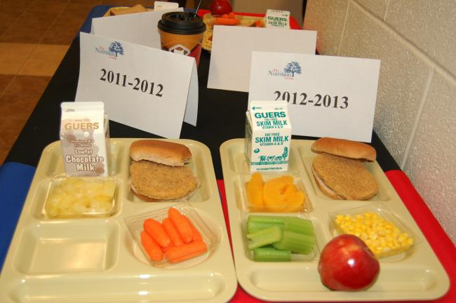CHRIS PARKER/TIMES NEWS Sample lunch trays show the differences between this year's school lunches and next year's.