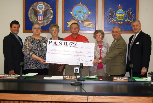 CHRIS PARKER/TIMES NEWS From left: Carbon County Commissioner Tom Gerhard; Carbon County chapter of the Pennsylvania Association of School Retirees president Marjorie K. Balliet; community service chair Janet Hall; member Charles Uhler; public…