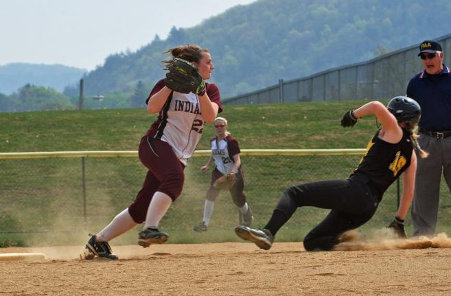 MIKE FEIFEL/TIMES NEWS Lehighton second baseman Brooke Lucykanish tries to turn a double play asNorthwestern Lehigh's Nicole Metzger slides into second base.