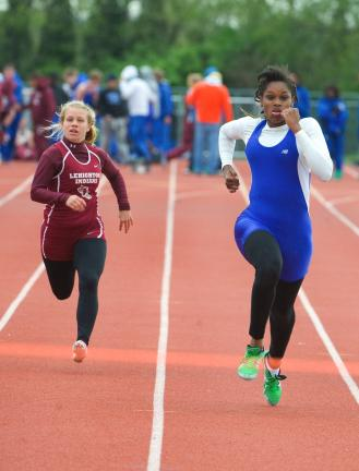 BOBO FORD/TIMES NEWS Pleasant Valley's Kelecia harris (right) sprints to the finish line in the 100-meter dash ahead of Lehighton's Sage Terembula. Harris won the event in 12.31.