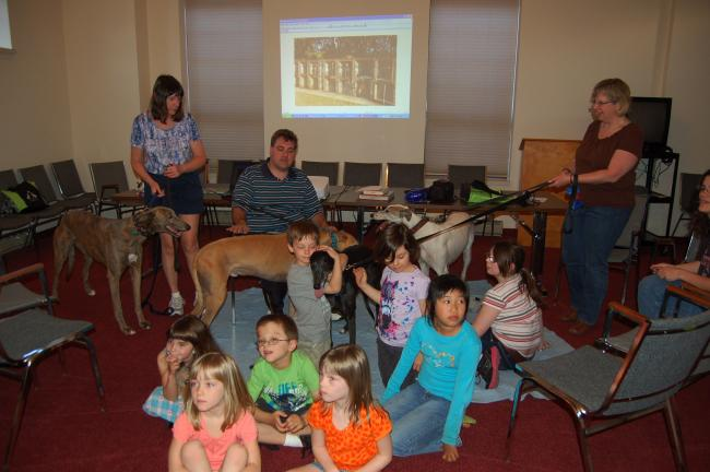 The Palmerton Area Library went to the dogs recently when four greyhounds visited, much to the delight of the children. Left to right, Kelso, Tina Stout, Shawn Green, Wiki, Comet, Clipper and Nina Green.