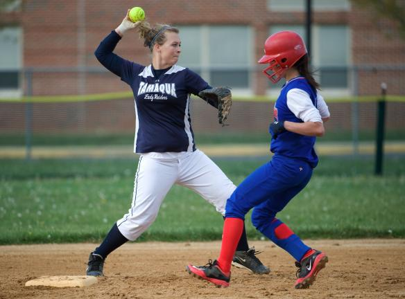 bob ford/times news Tamaqua's Briana Boyle (left) gets set to make the throw to first base after forcing out Jim Thorpe's Nicole Murphy.