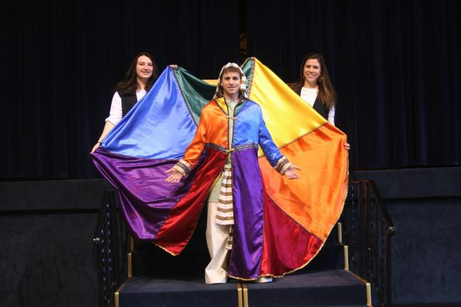 SPECIAL TO THE TIMES NEWS Stephen Valente as Joseph, and Miranda Milillo, left, and Joanna Butala as the narrators in Marian Catholic High School's production of Joseph and the Amazing Technicolor Dreamcoat, this weekend at the high school in Hometown.