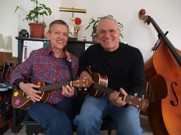 AL ZAGOFSKY/SPECIAL TO THE TIMES NEWS Judy Greig on the soprano ukulele and Sy Kipp on the baritone ukulele form the duet, SyanI. SyanI debuted last Saturday at the Groovy Uke benefit concert.