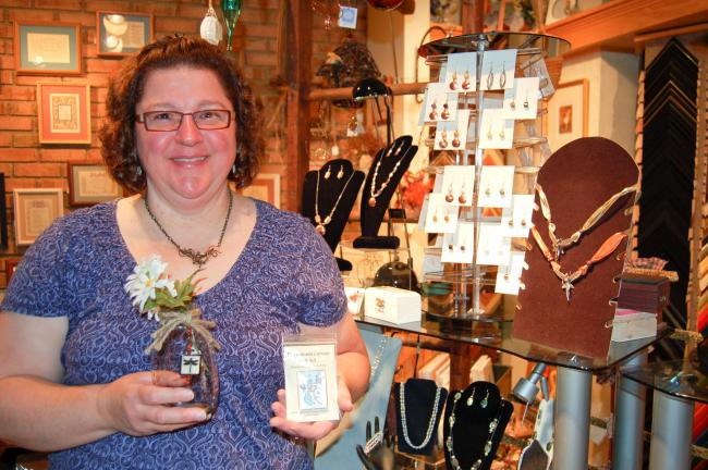 LINDA KOEHLER/TIMES NEWS Carla Binder, owner of Creative Framing by Carla, and artist, is also the Craft Chairperson for the Palmerton Community Festival's Craft Tent. She is looking for crafters of handmade items like she features in her shop, to…