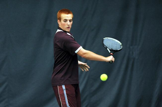 NANCY SCHOLZ/Special to the TIMES NEWS Lehighton's Nick Mantz keeps service during District 11 2A Doubles action at West End Racquet Club. Mantz and James Sverchek advanced to the second round before losing.