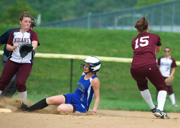 BOB FORD/TIMES NEWS Pleasant Valley's Jordan Meckes slides into second base as Lehighton's Emily Kollar (15) takes the throw. Brooke Lucykanish backs up the throw for the Indians.