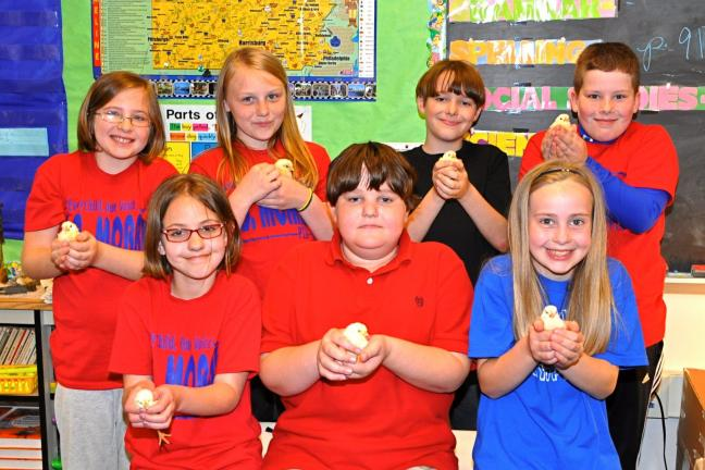 "VICTOR IZZO/SPECIAL TO THE TIMES NEWS Gently holding some of the chicks hatched out during their fourth grade's 4-H project called ""Embryology"" are L.B. Morris Elementary School students, front, left to right : Teegan Kunkle, Tanner Horn, and…"