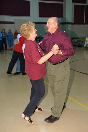 AMY MILLER/TIMES NEWS Fran Haas and Henry Long of the Lehighton team compete in the slow dance competition of the Carbon County Senior Games. The pair went on to capture a bronze medal in the event.