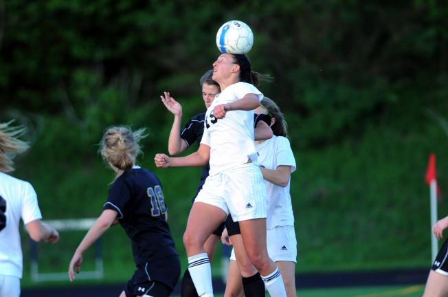 nancy scholz/times news Sarah Jones of Northwestern (15) goes high to head the ball against Palisades.