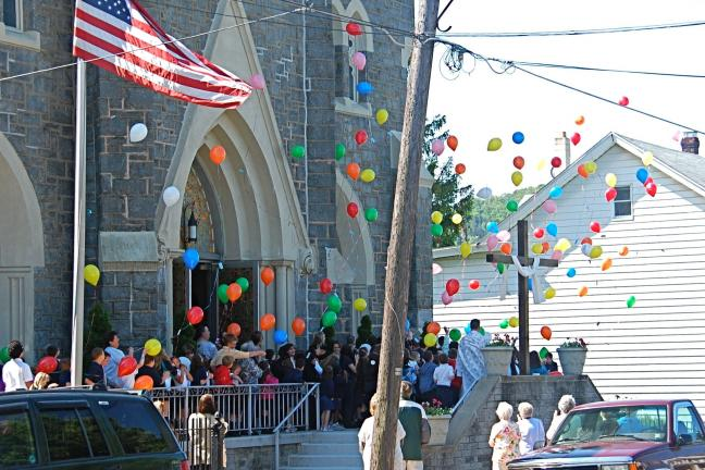VICTOR IZZO/SPECIAL TO THE TIMES NEWS Up, up, and away! The multitude of colorful balloons released by the students of St. Joseph Regional Academy in Jim Thorpe drift skyward away from St. Joseph Church on their way to the heavens above.