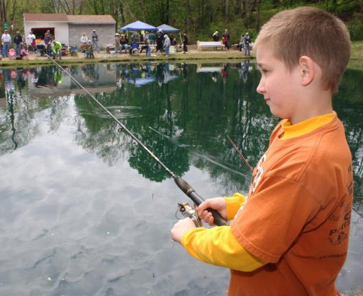 ANDREW LEIBENGUTH/TIMES NEWS Dylan Nelson, 11, reels in a catch during the Kellner's Dam Fishing Derby.