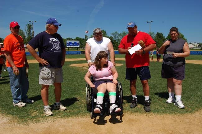 "Gail Maholick/TIMES NEWS Sabrina Steigerwalt, 13, of Jim Thorpe, is presented with cash and checks totaling $2,000 during the annual Russell ""Bups"" Ahner Memorial benefit baseball game. From left are Larry Ahner, Wayne Wentz, Sabrina, Jim Zurn and…"