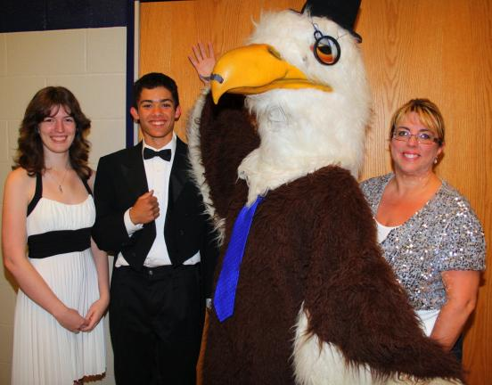 "ANDREW LEIBENGUTH/TIMES NEWS Pictured walking the red carpet during the film festival event were, from left, students Victoria White, 18; Jacob Gursky, 15; ""High Class"" Raider mascot, wearing a top hat and monocle; and teacher Kim Woodward."