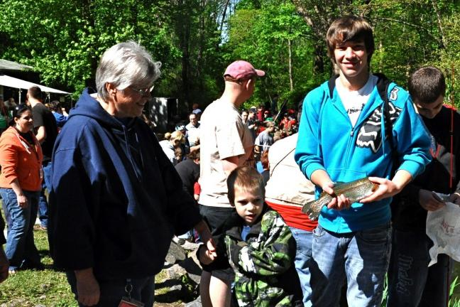 VICTOR IZZO/SPECIAL TO THE TIMES NEWS CCTI volunteer helper Matt Henritzy holds the rainbow trout that was caught by L.B. Morris 1st grade student Konnor Roy.