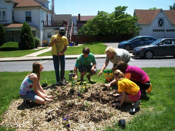 JASON SANDER/SPECIAL TO THE TIMES NEWS Planting flowers in downtown Lehighton to commemorate 100 years of 4-H in Pennsylvania is, from left, Eliza Asmann, Brandon Ruch, Brandon Everett, group organizer Kay Gilbert, Brianna Keiser and Erin McGinley.
