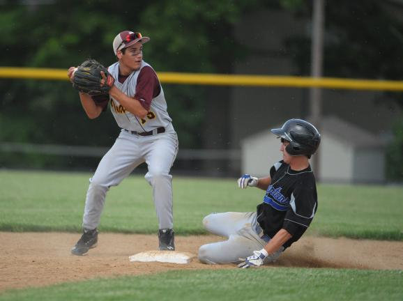 Bob Ford/TIMES NEWS Lehighton's A.J. Wenrich looks to first after tagging the base to force out Southern Lehigh's Connor Vanin during Tuesday's District 11 Class 3A quarterfinal.
