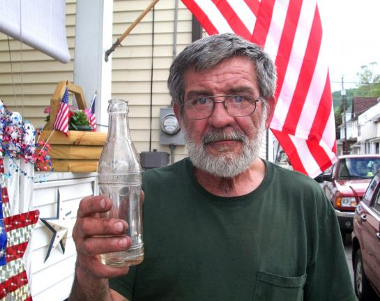 DONALD R. SERFASS/TIMES NEWS Earl Edmondson, Tamaqua, unearthed a rare soda bottle from Tamaqua's heyday and would like to learn more about its origins.
