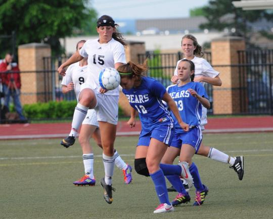 DON HERB/SPECIAL TO THE TIMES NEWS Pleasant Valley's Katie Forte (12) heads the ball away from Northwestern's Sara Jones (15). The Bears' Gabby Lucchese (23) is in the background.
