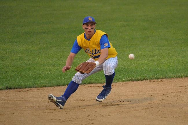 bob ford/times news Marian's shortstop Mike Cataldo goes into the hole to backhand the ball.