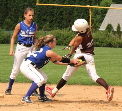 LINDA ROTHROCK/Special to THE TIMES NEWS Palmerton's Martina Herring puts the tag on Catasauqua's Ali Gesick after the latter tried to stretch a single into an extra base hit. Gesick was out on the play and the Lady Bombers went on to beat the…